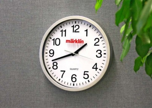 Wall Clock with a Railroad Station Design